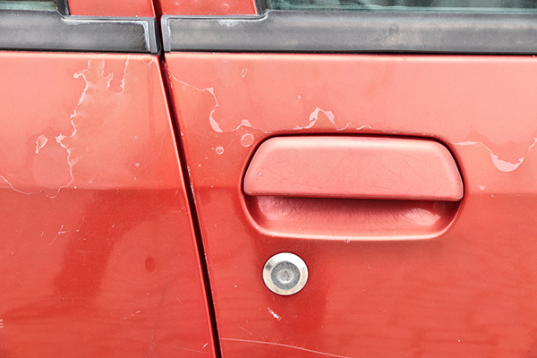 red car with sun damage can repair in auto body shop